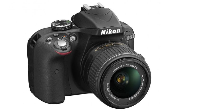 Image of a black Niko D3300 DSLR camera with a thick manual focus lens.